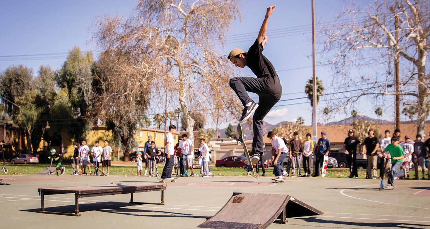Local skaters, scooter and BMX riders show off their tricks.