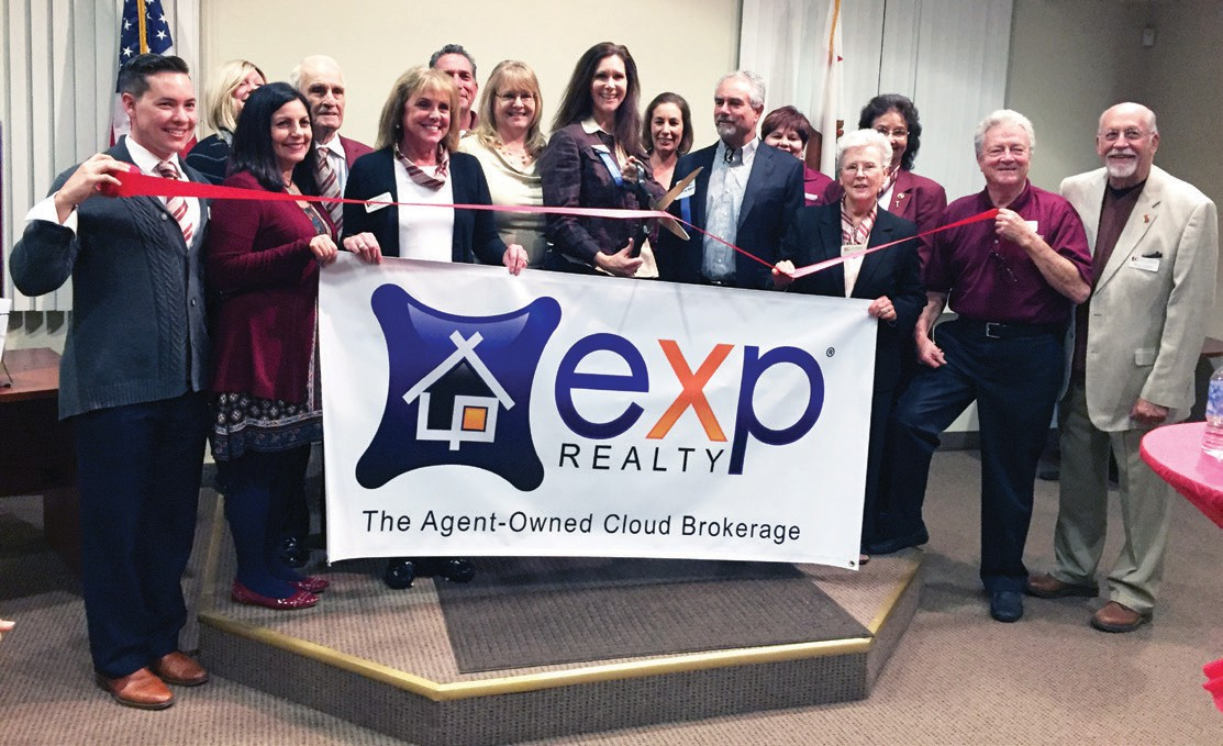 EXP Realty celebrated their ribbon cutting during the festivities. They don't have a physical building for the association, so that's why they had the ribbon cutting in the Chamber office.