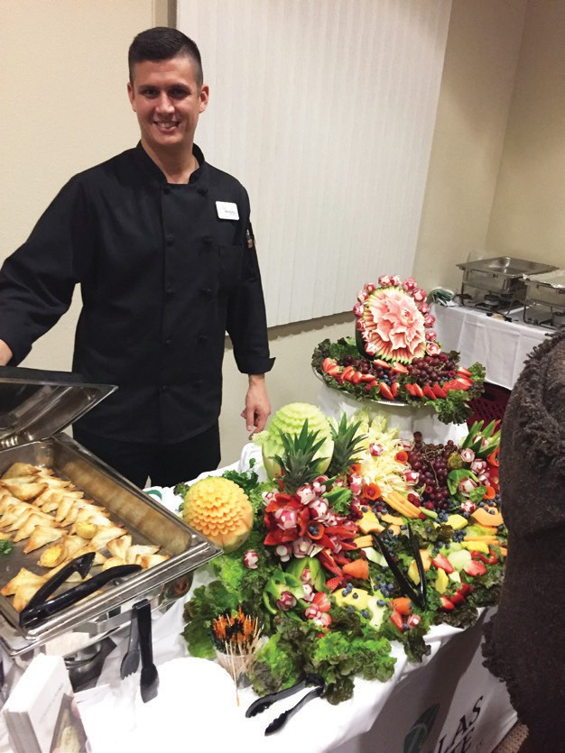 Chef Randall from Las Villas Del Norte Retirement community serving up some savory food.