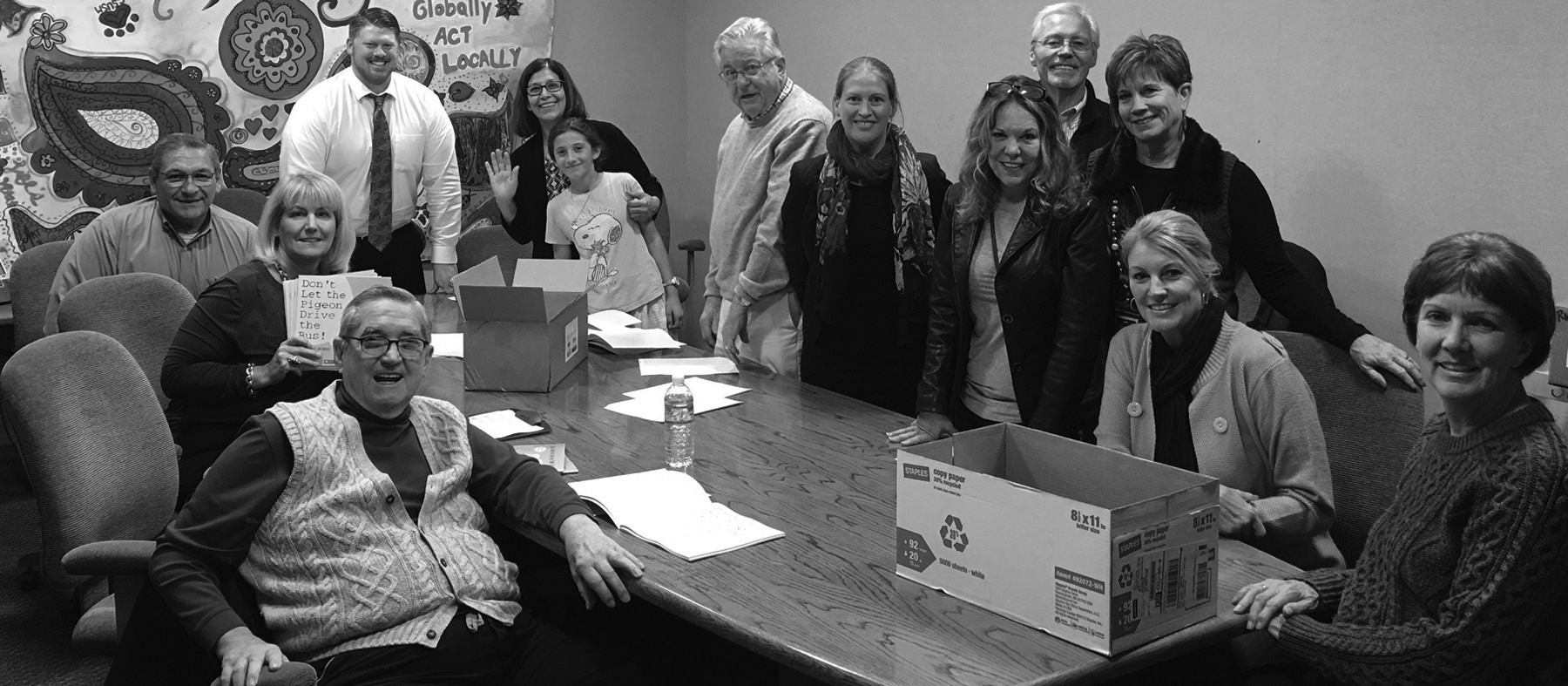 Pictured are Rotary Club members preparing the books for distribution to seven elementary schools in San Marcos Unified School District as part of the Clubs' Literacy Project. L to R around the table are Bob Derry, Lynn Hunter, Ed Musgrove, Jesse Dix, Matilda and Sylvia Rough, John Wilson, Stephanie Jungersen, Kelly Crews, Darrell McMullen, Holly Malan, JulieRae MacLeod and Peggy Martin.