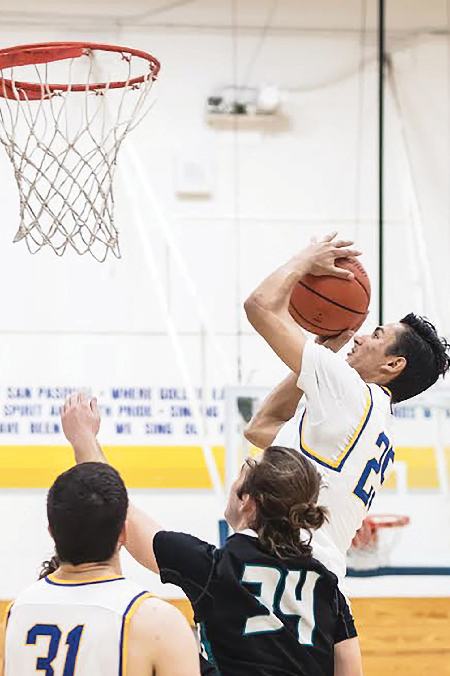 Sophomore Elijah Jackson goes hard to the hole during Friday night's 61-53 loss to Valley Center.