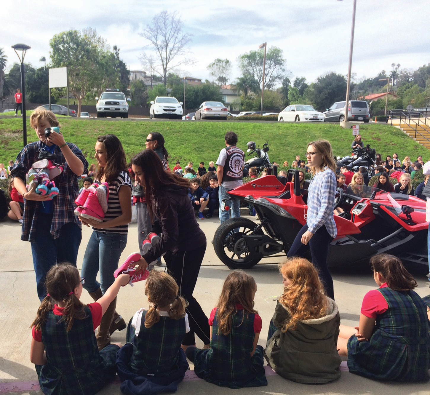Escondido Christian High School students collect shoes donated by elementary students.